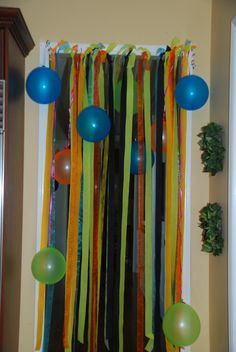 I should do this to the entrance to the glow in the dark room but all neon streamers ;)