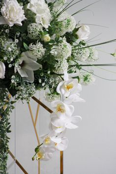 http://partydesign.com.au/centerpieces/index.htm  Spring's Breath centrepieces with more white flowers added on stand with gold elements