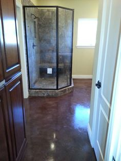 How Gorgeous is this Floor!! Walnut Stain on Master bathroom floor! Premier Concrete Designs, LLC Fayetteville AR 479-387-7895 Give Russ a call today about Transforming your home.