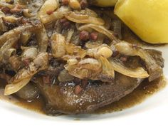 A 5-star recipe for Baked Liver And Onions With Bacon made with beef liver, bacon, onions, butter or margarine, dry red wine, parsley, bay leaf, thyme