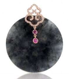 A BLACK JADEITE PENDANT  A round black jadeite plaque measuring approximately 40.75 x 3.92 in diameter and thickness respectively, to a hook surmount decorated with a fancy double ruyi-shaped set with circular diamonds with two rubies suspending, mounted in 18k rose gold.