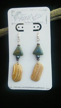 Check out this item in my Etsy shop https://www.etsy.com/listing/212087526/shell-earrings-with-beautiful-bead-3
