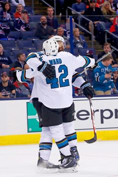 San Jose Sharks defenseman Brent Burns celebrates with forward Joel Ward after the duo connected on Ward's first period goal (Oct. 15, 2016).