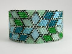 A one of a kind, fun, fashionable cuff bracelet. This bracelet was hand-woven by me, in peyote stitch and it is made of size 11 Japanese glass seed beads. The bracelet was beaded with needle and thread and the beads were added to the pattern one by one taking many days to complete. The length of the bracelet: 6 3/4 The width of the bracelet: 7/8 For size reference please see the last photo. The mannequin hand is the same size as my hand and I am a 59 female. You will receive the exac...