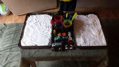 Trays of baking soda, colored vinegar, medicine droppers and matchbox cars..my son loves it! Hours of play