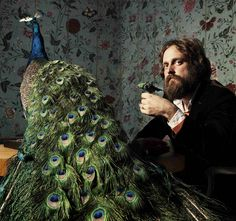 Iron and wine. The man's beard is enough to impress me but throw in the fact that he spends his time sitting with peacocks...he's wonderful.