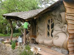 Ornate cob. Such a great construction material. Very green, very energy efficient, very inexpensive. Lends itself to all sorts of artistic possibilities.