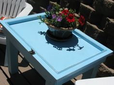 How to Make a Table from a Cabinet Door ~ If you recently renovated your kitchen or came across a stash of old cabinet doors, here is a fun repurposing project for you! Turn that cabinet door into a side table!