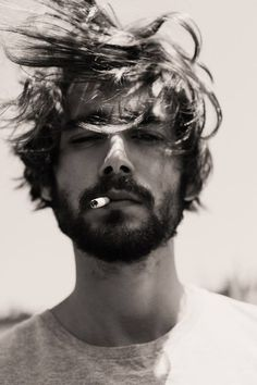 Smoking. Eww. But otherwise very handsome man.