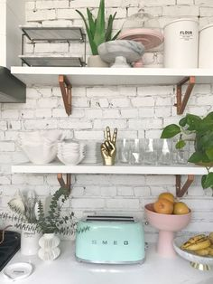 of my light and bright kitchen! I love the white washed exposed brick backsplash and the open shelving. It makes it so much fun to style! Kitchen Shelves, Kitchen Decor, Kitchen Design, Kitchen Cabinets, Bathroom Shelves, Cupboards, Rustic Kitchen, Country Kitchen, Kitchen Ideas