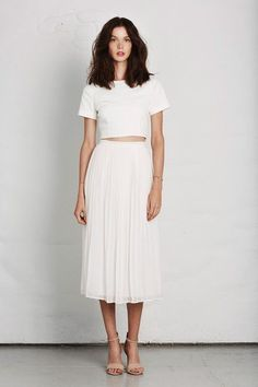 Minimal + Chic glamhere.com All white outfit. Midi skirt and short shirt.