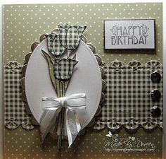 Paper piecing. Nice layout. Black and white gingham on craft and white dots. The brads give it balance