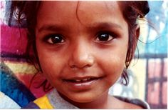 Christel House India Student - I took this photo back when I was in India in 2001.  This little girl was glued to my hip the entire time.  I absolutely adored her and miss her still. Her nose constantly ran, she weighed as much as a flea, and being in her presence was pure joy.  I can only imagine where she is today.  Sending her love.