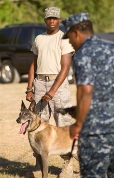 "Navy Master at Arms 1st Class Ekali Brooks (back to camera) works with future dog handlers at Lackland Airforce Base. ""It's the best job in the world,"" he says. (Photo copyright Robin Jerstad)"