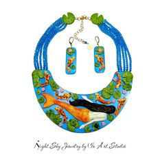 Mermaid Necklace & Earrings Colorful Koi Fish by InArtStudio, $292.00 Envision a shimmering sapphire blue Koi pond, with a Koi Mermaid surrounded by colorful Koi fish, lily pads and pink lilies.