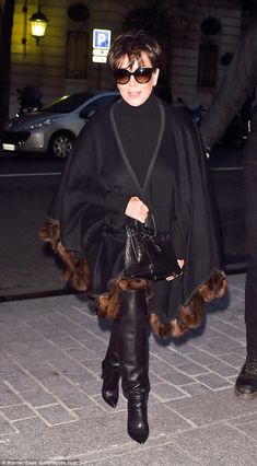 Flashing the cash: She's been enjoying the various catwalk shows at Paris Fashion Week - and Kris Jenner treated herself to a shopping trip in the French capital on Monday