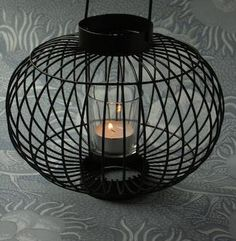 tea candle in cage