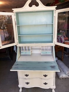 Secretary: Annie Sloan Chalk Paint in Duck Egg Blue and Old Ochre, with a touch of silver highlights in the recessed trim areas (using a paint pen). Coated with clear wax. by joanne.cavanaugh.94