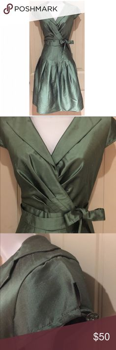 """Kay Unger New York Green silk green dress size 8 Kay Unger New York Green  Size 8  Steel green color  Silk with poly lining   Zips up side  Has attached belt  Button detail on sleeves   Excellent condition   Bust 18"""" Waist 15"""" Length 39""""  Retail $390 Kay Unger Dresses Midi"""