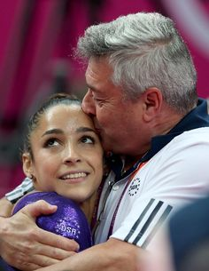Alexandra Raisman of the United States hugs coach Mihai Brestyan during the Artistic Gymnastics Women's Team qualification on Day 2 of the London 2012 Olympic Games at North Greenwich Arena on July 29, 2012 in London, England.
