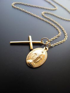 I need a gold chain with the Cross and the Virgin pendants to wear everyday.