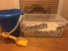 "Ashley Kapinos- ""Speech Beach"" This activity is used to target expressive and receptive language, specifically identifying objects and answering WH- and Yes/No questions. The children will dig objects out of the ""sand"" and identify them then add it to the bucket. Buried in dry white rice are small figurines of common objects. This activity was designed for preschool disabled students and, in addition to language, targets pragmatic skills such as turn-taking and following directions."