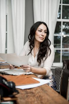 When Joanna Gaines is working on a home reno project on HGTV's Fixer Upper or running around her home decor store, Magnolia Market, she's rarely seen without