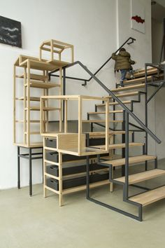 The staircase of  Industrial Landscape 01  has a fixed position in the room and consists of a steel support structure with solid oak stairs. The surrounding volumes are freestanding and not attached to the space, allowing the user to move them around freely and deploy them as (display) furniture anywhere in the room. The volumes are made of solid oak combined with black MDF drawers, glass panels and linoleum-clad shelves.