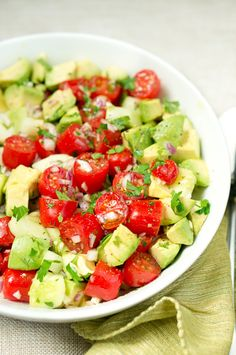 One of my FAVORITE summer dishes! Tomato cucumber avocado salad. So colorful, flavorful and easy too! | www.deliciousmeetshealthy.com #avocado #tomato #paleo #glutenfree #salad #summer #BBQ #grilling #cucumber #healthy