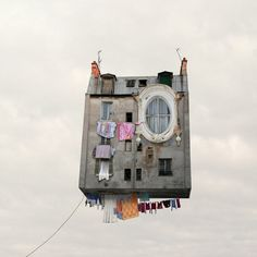 UP!!     Laurent Chehere: Flying Houses - The Yellow Umbrella