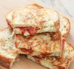 Yummy pizza and grilled cheese combined together. Two of my favorite things in this world :). This great sandwich combines pizza and grilled cheese. This is a great lunch sandwich. If you love pizz...