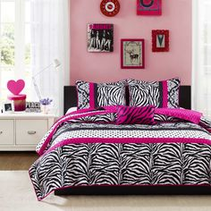The Mizone Gemma Collections offers an edgy yet girly look for your space. The stripes of polka dots, damask print and zebra print create the perfect balance while the hot pink decorative pillow uses black zebra embroidery to pull this look together.