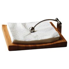 Bamboo napkin holder with a stainless steel arm.  Product: Napkin holderConstruction Material: Bamboo and stainl...