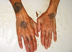 Tattooed Croation female hands. Part of a secret Catholic cult that developed while Bosnia was occupied by Ottoman Empire. The cult members identified each other by tattooing their hands and arms using a compound ink that was made up, in part, of human breast milk.