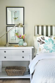 wide nightstand, bird art and striped headboard.   Mission, find a table like this. My bedroom needs it