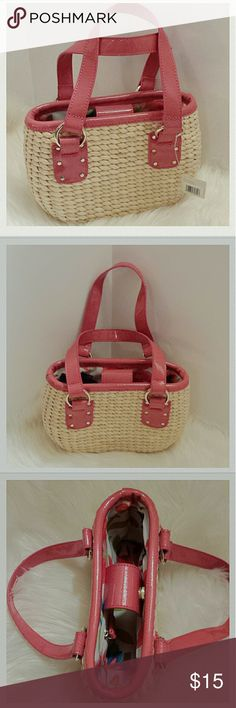 """NWT Liz Claiborne Pink Trim Straw handbag 9"""" in length by 6 3/4"""" high by 3 1/2"""" wide with 8"""" straps Gold hardware on straps and magnetic closure. Perfect straw weave with pink detail trim on opening and straps. Pretty floral lining. NWT. Liz Claiborne Bags Mini Bags"""