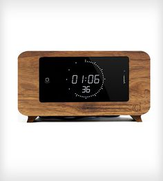 CDock iPhone Desk Clock If you love your iPhone this simple dock is a great addition to any Apple Mac lovers desk. With the ability to change your clock display you should never get bored looking at this sleek little iPhone holder. Iphone Clock, Iphone Charger, Objet Deco Design, Iphone Docking Station, Clock Display, Retro Clock, Ex Machina, Digital Alarm Clock, Wooden Pallet Projects