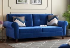 Get this velvet Orlando 3 seater fabric sofa at Rs. Rs 33,589. Its low aremrest give unique look. Order online at Wooden Street. #sofa #sofas #velvet #fabricsofa #3seatersofa