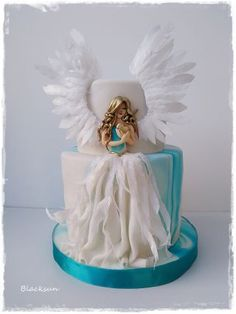 :) birthday cake for a good man :) Angel of love :) inspiration from Sihirli Pastane and her Angel in the Dark :) wings and feathers on the dress are from wafer paper :)