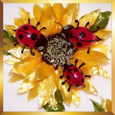 Edible sugar sun flower with lady birds from caramel Flowers UK. Ideal as cake decoration, wedding cake decoration or gift.Made of isomalt and suitable for diabetics.
