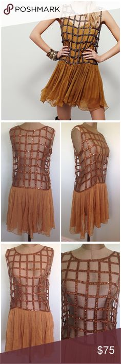 Free people tan Sequined Shell dress sz XS FP Sequined shell dress   *sz XS  *light tan brown color  *NEEDS A SLIP!  * *see through  *sequined pattern  *sheer skirt part  *has extra sequins  *never used, bought it without a slip.  *first photo to show style   *measurements *laying flat,  *BUST-  *length of Sequined part- *length of skirt part -  *TOTAL LENGTH-  * Free People Dresses