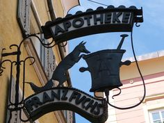 Beautiful artistic shop sign in Laufen, Bavaria, Germany.