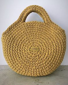 By Mariza Crochet Designer: Blusas e casaquinhos CrochetCrochet T-shirt Purse - Salvabrani - SalvabraniThis Pin was discovered by EugSurprising Benefits of Crochet & Knitting as We Get Old - Splash ColoursHow to Crochet a Beautiful Bag Bag Crochet, Crochet Pillow Pattern, Crochet Purses, Crochet Patterns, Diy Crafts Crochet, Round Bag, Crochet Round, Knitted Bags, Handmade Bags