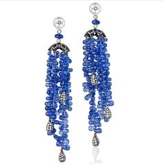 """""""You are not just a drop in the ocean, you are an ocean in a drop."""" - Rumi  A gorgeous pair of sapphire earrings from the master Fabio Salini. Teardrop shaped beads that are purely arranged in a manner that give it that classic grape wine look, along with a black gold setting drop that enhances the diamonds. Standard unique. @fabiosalinijewelry  #thegemdialogue #jewelryblogger #picoftheday #oneofakind #luxury #designer #indiainspired #sapphire #bridal"""
