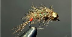 Hook: BL # 12   Thread: 8/0 black.   Tail : Brown mallard.                  Body: Uni-Thread Fire Ora. , dubbing mask ...