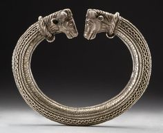 Silver ring of Trichtingen Silver ring of Trichtingen  Late La Tène, 1 c. V. Chr. The magnificent silver ring with a bull's head ends was discovered by chance during drainage work in the vicinity of Trichtingen.