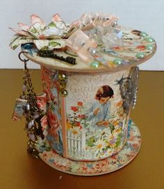 Scrap Happens Here: altered gravy tub made into a cotton reel.
