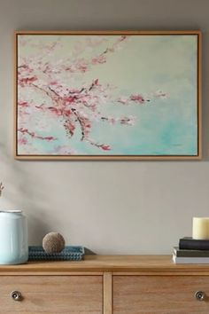 Simple serene, the Cherry Blossom Bloom Framed Canvas with Gel Coat offers a beautiful update to your decor. Delicate cherry blossoms, in pink hues, bloom against a soft blue background to create a peaceful and charming look. A gel coating adds a glossy s Asian Home Decor, Chip And Joanna Gaines, Framed Canvas, Cherry Blossoms, Blue Backgrounds, Diys, Delicate, Wall Decor, Rustic