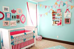 Girly Pink and Aqua Nursery with chevron accents, bedding from @Caden Lane and a fab gallery wall!