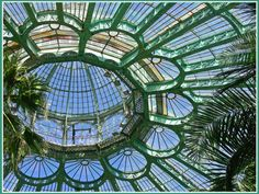 The inside of the dome of the Royal Greenhouses on the domain of Laeken Park in Brussels, Belgium. By Suzy.